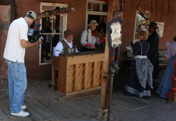 The mayor and his wife enter the saloon